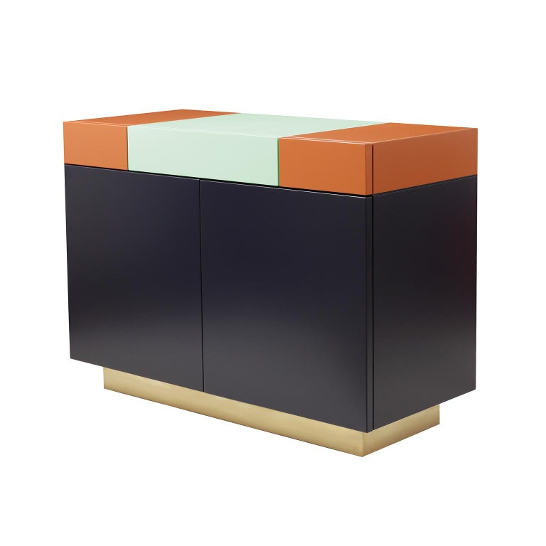 A functional and practical cabinet, based on a feminine discrete elegance, Greta combines a playful geometrical assembling of shapes and colors.