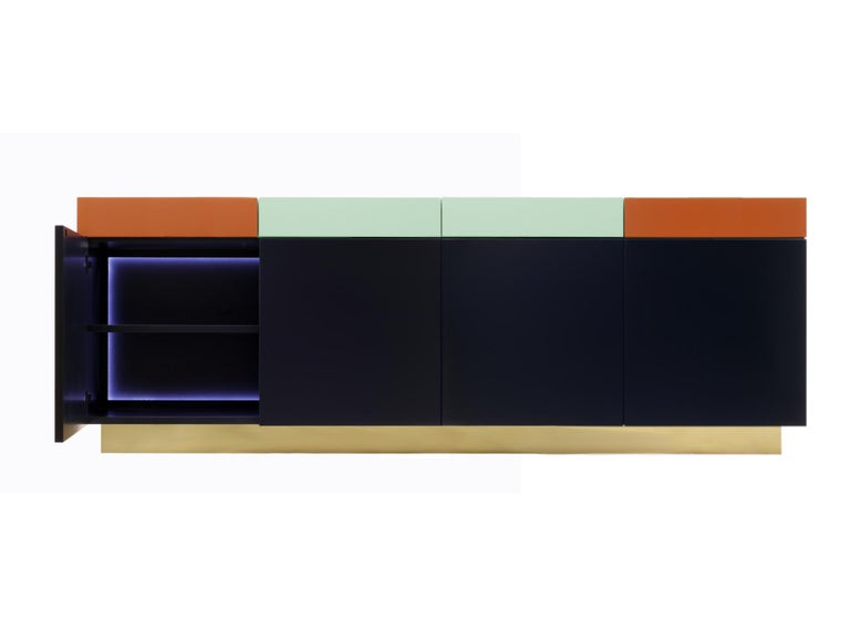 A functional and practical cabinet, based on a discrete elegance, Greta combines a playful geometrical shapes, colors and woodwork. The outside is formed by 4 drawers on top and 4 doors beneath them, all of which with the lacquer color painting,