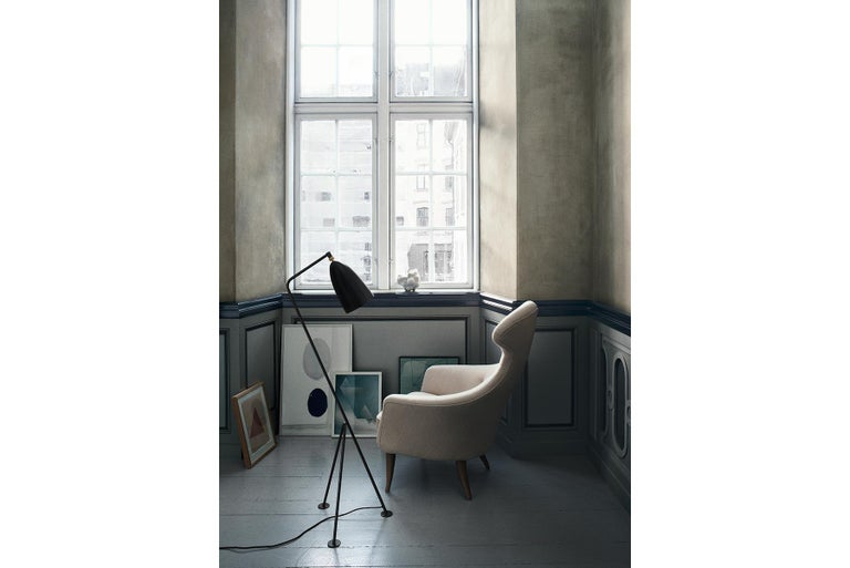 The iconic Grasshopper Floor Lamp was first produced in 1947 by the feminine pioneer Greta M. Grossman. The unique tripod stand of the Grasshopper Floor Lamp is tilted backward and gives the impression that the lamp is somehow alive and stalking its