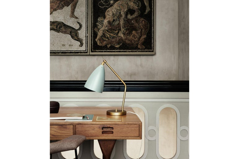 Greta M. Grossman designed the iconic Gräshoppa table lamp in 1947 and with its sophisticated yet playful design, it is still as relevant today. The distinctive, elongated conical shade is beautifully combined with a tubular brass stand, a great