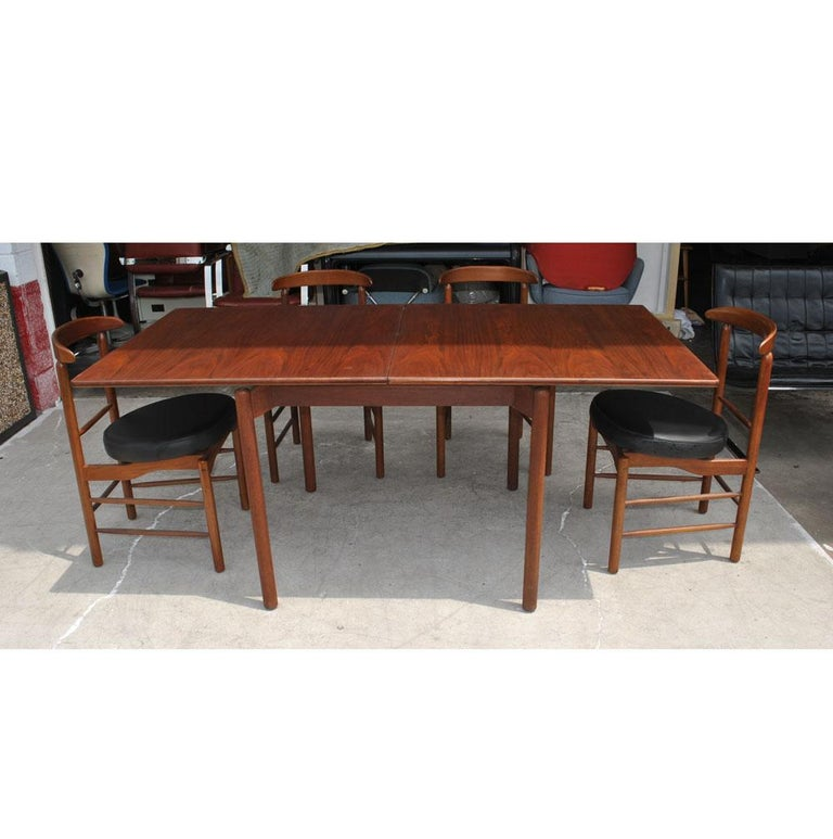 European Greta Grossman Midcentury Teak Expandable Dining Table and Chairs For Sale