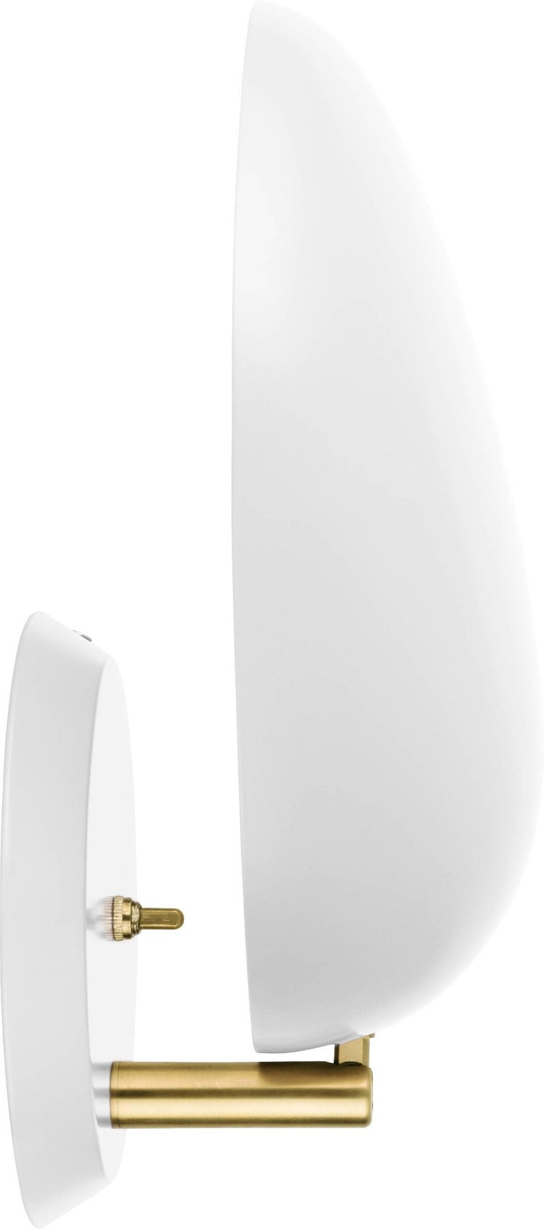 Greta Magnusson Grossman 'Cobra' wall lamp in white. Designed in 1950 by Grossman, this is an authorized re-edition by GUBI of Denmark who meticulously reproduces her work with scrupulous attention to detail and materials that are faithful to the