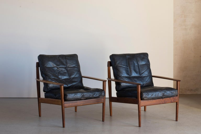 Grete Jalk easy chairs of rosewood and leather. Executed by France & Son, Denmark.