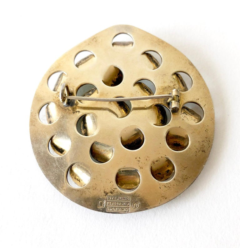 Iconic, lightly gold plated sterling silver brooch with emerald green enameled scales or tabs created by Grete Prytz Kittelsen of Oslo, Norway.  Brooch measures 2.25