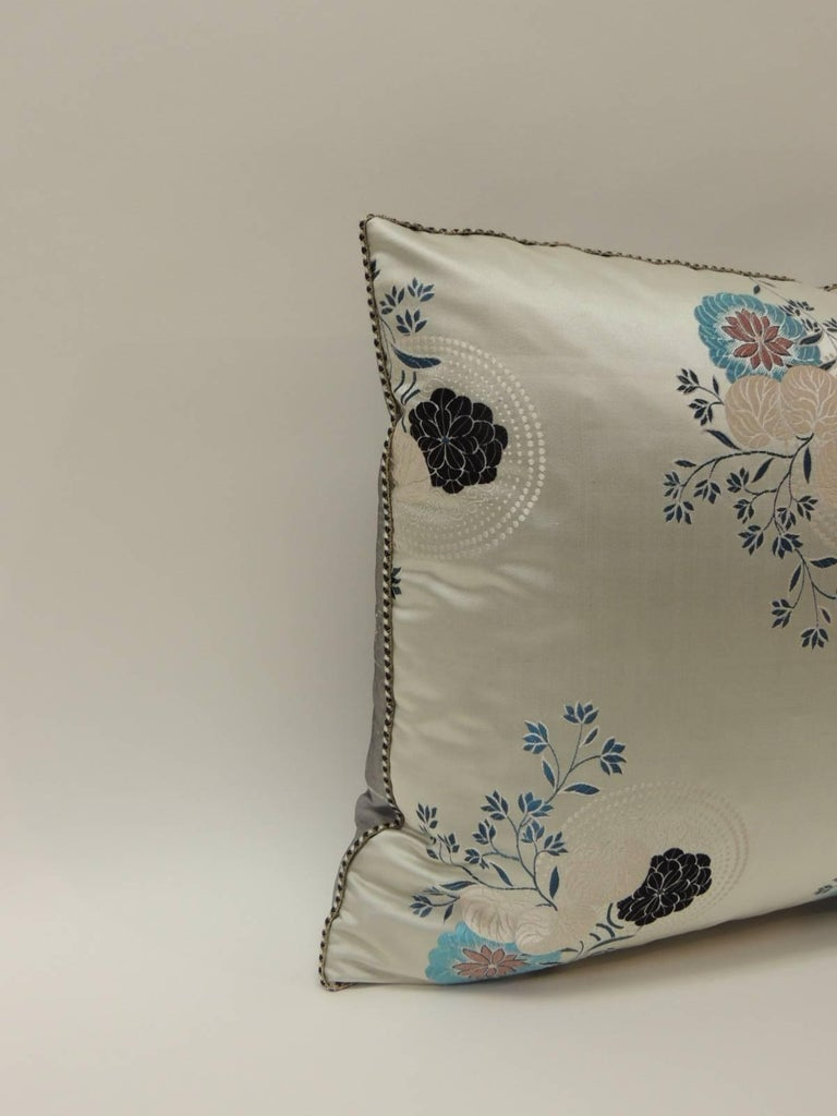 Vintage Grey and blue Japanese silk floral Obi decorative bolster pillow Japanese silk brocade has been used to create a beautiful decorative bolster pillow. Floral textile embellished with a vintage decorative silk trim all around. Grey satin