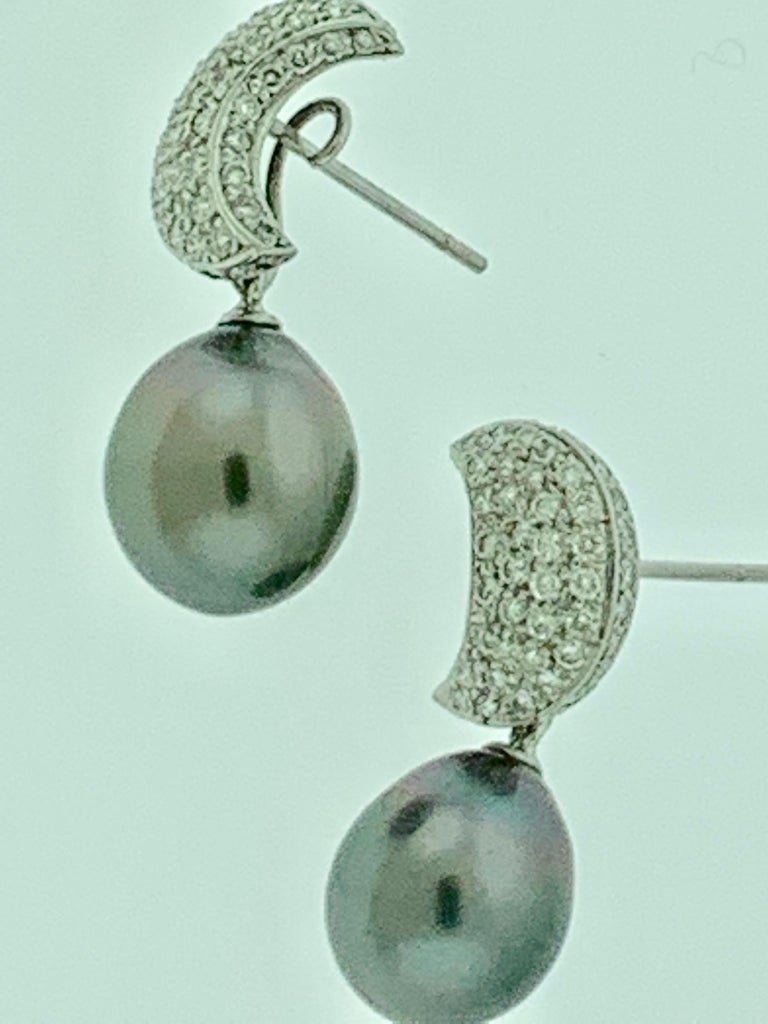 A beautiful pair of 8-9 mm Tahitian South Sea cultured pearl earrings with gorgeous 18K gold mountings.  Black Tahitian Cocktail Earrings With Diamonds 18 Karat White Gold  All pearls are absolutely clean with no blemishes .Approximately 8 mm