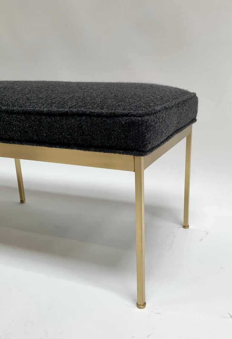 The Paul Bench features a solid lacquered brass base and an upholstered seat with piping. Each leg features a rounded leveler. Shown here in grey boiled wool and satin brass.  The Lawson-Fenning Collection is designed and handmade in Los Angeles,