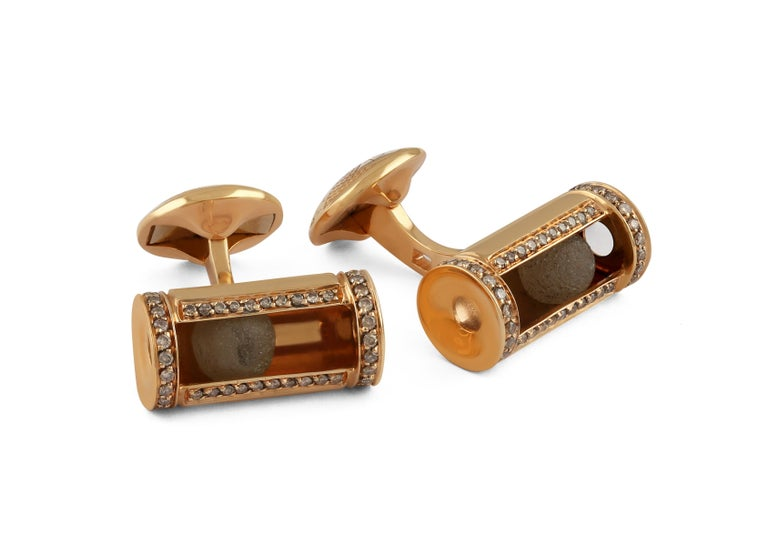 A magnificent collection of rough and polished diamonds, set within a simplistic case, decorated with frames of pave diamonds. A unique collection of one-of-a-kind cufflinks, each case expertly designed to capture the diamonds exact periphery.