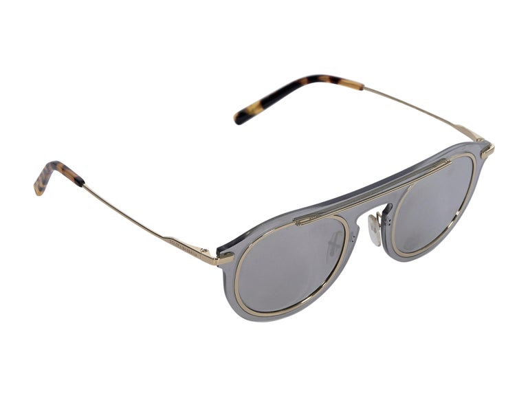Product details: Grey mirrored aviator sunglasses by Dolce & Gabbana. Gold-tone metal trim. Gold-tone and tortoise-shell stems. Style yours with a metallic knit swimsuit. Case included. 6.5