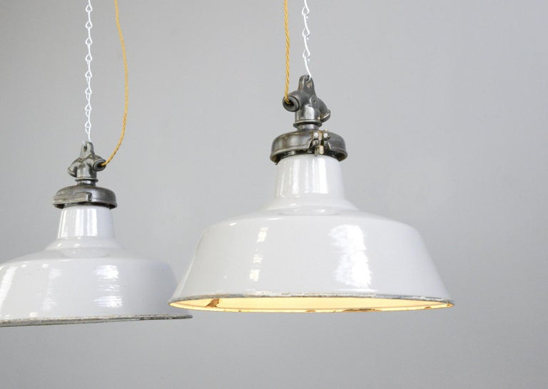 Grey enamel factory lightsby Credalux, circa 1930s  - Price is per light (4 available) - Vitreous grey enamel shades - Cast iron tops - Takes E27 fitting bulbs - Made by Credenda Simplex, Oldbury - Salvaged from the England's Glory Match