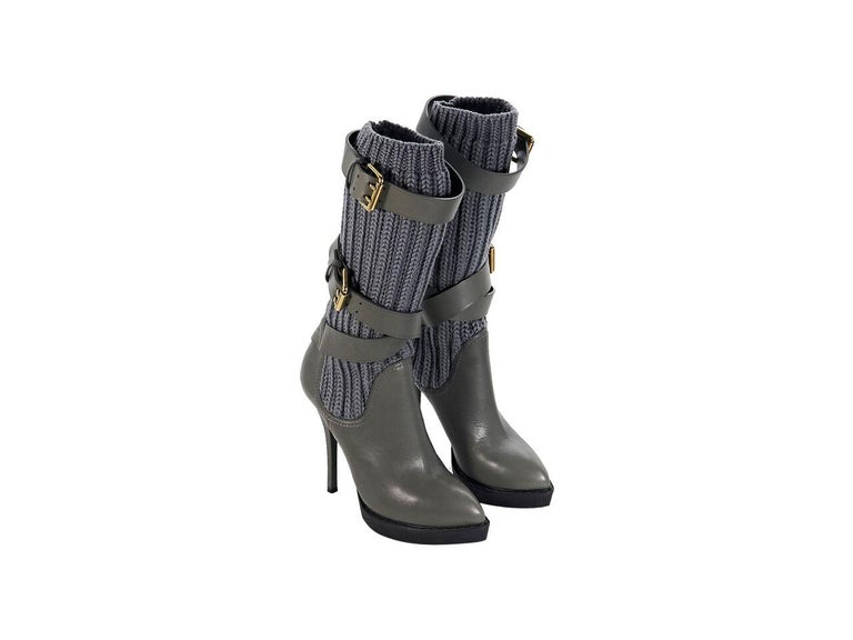 Product details:  Grey leather platform boots by Gucci.  Buckle straps accent knit shaft.  Pull-on style.  Goldtone hardware.  5