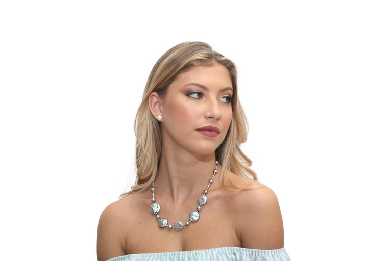 Freshwater Grey Pearl Necklace with 16 Semi-Round Grey Pearls Measuring 8.5-9mm Each and 5 Central Coin Pearls Measuring 20mm Each. Beautifully Spaced with Sterling Silver Diamond Cut Beads.