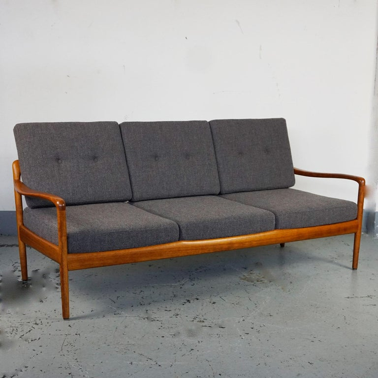 Organic 1960s teak 3-seat sofa in very good condition with new Kvadrat fabric upholsterd cushions by Knoll Antimott, Germany 1960s, Mid-Century Modern design. The legendary