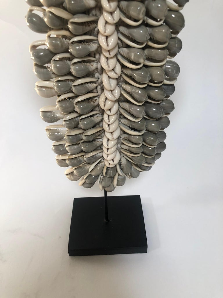 Detailed shell necklace on stand from Asia.