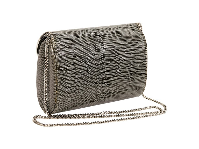 Product details:  Vintage grey lizard skin crossbody bag by Gucci.  Circa the 1980s.  Tuck-away chain crossbody strap.  Lined interior with inner slide pocket.  Silvertone hardware.  7