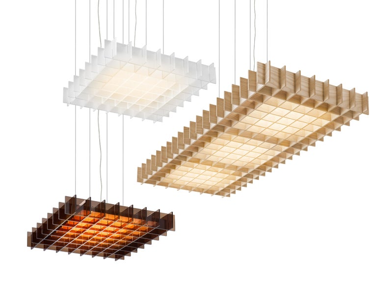 Grid conveys a lightness and weightlessness of form in its orderly structured frame of natural wood or optically clear acrylic. The CNC cut slats provide both optimal diffusion from side viewing angles while celebrating a rich palate of natural