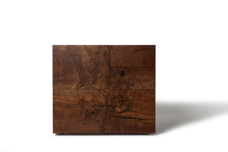 The Grid Cabinet by Taylor Donsker features hand dovetailed solid walnut casework that waterfalls down the left hand side while black oxide steel plate wraps around the back and right side. Open the hand dovetailed, solid walnut drawers by pulling