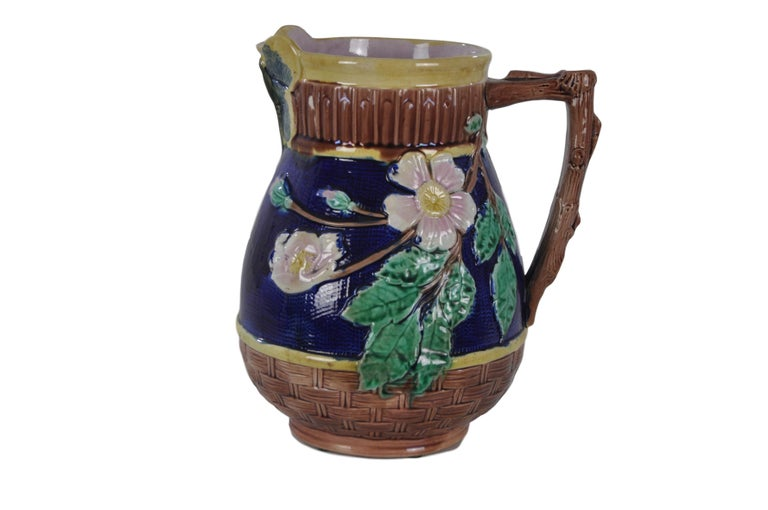 Etruscan majolica dogwood pitcher in bark and vibrant navy with butterfly lip manufactured by Griffen, Smith and Hill of Phoenixville, Pennsylvania, ca. 1885 For over 28 years we have been among the nation's preeminent specialists in fine antique