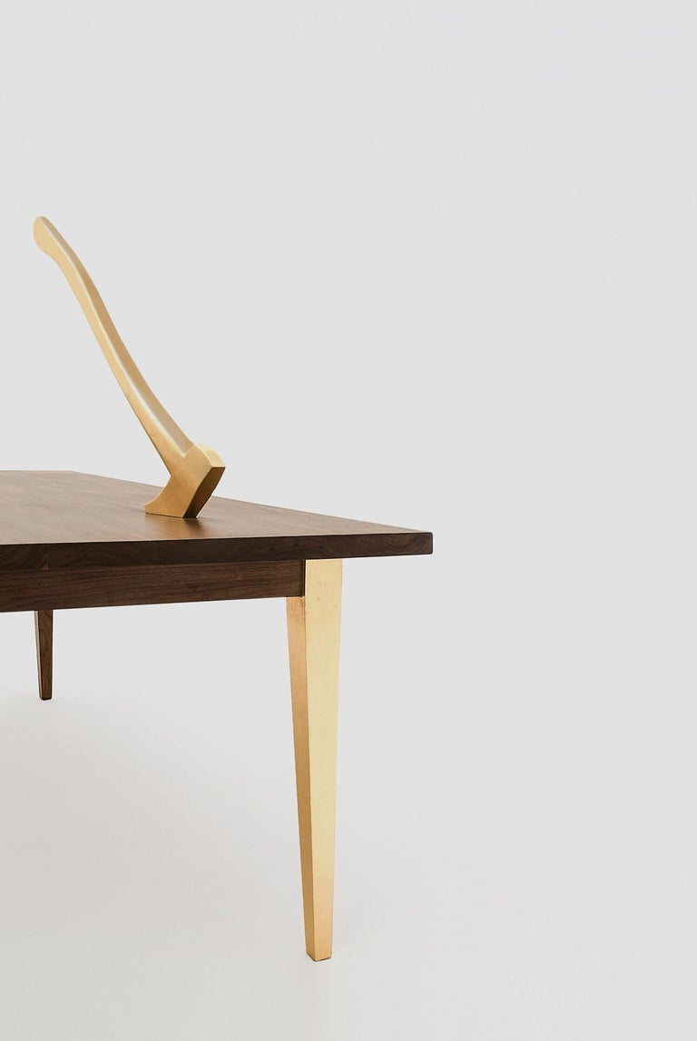 Grimm walnut and gold table was designed by Hugo Lugo for Breuer ESTUDIO. This piece is part of Arte y Ebanistería 2018 collection in which Hugo collaborated with Breuer to create exceptional pieces.  Hugo Lugo has a B.A. in Visual Arts from the