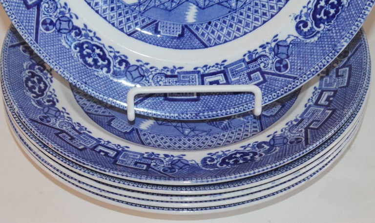 Serve ware made to last 19th century blue willow with the typical blue willow pattern. This set is stamped