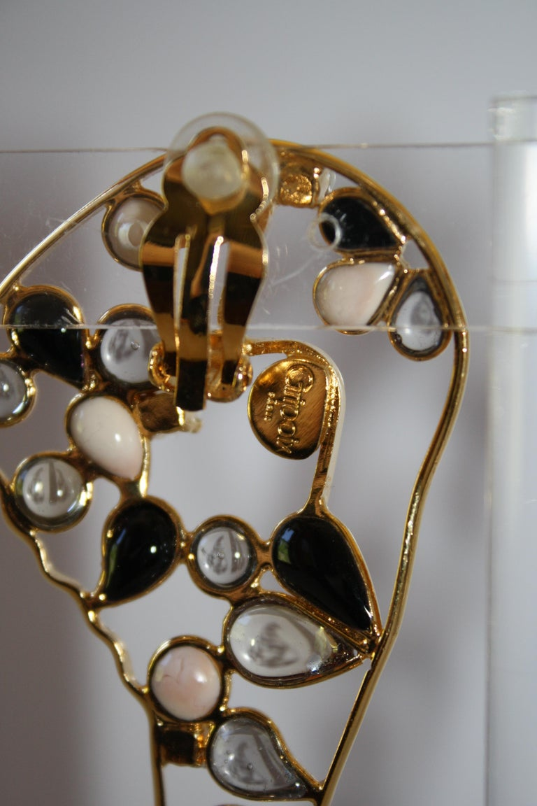 Safari inspired clip earrings in poured glass from Gripoix Paris.?