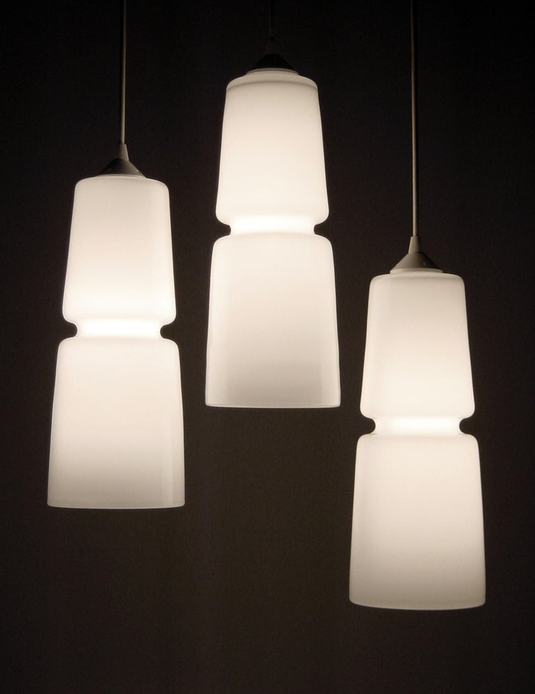 These hanging lights feature an embedded groove that offers a precise, machine-made quality to offset these otherwise wholly handmade creations. Whether showcased individually, as an aligned set or an organic cluster, these designs create a lustrous