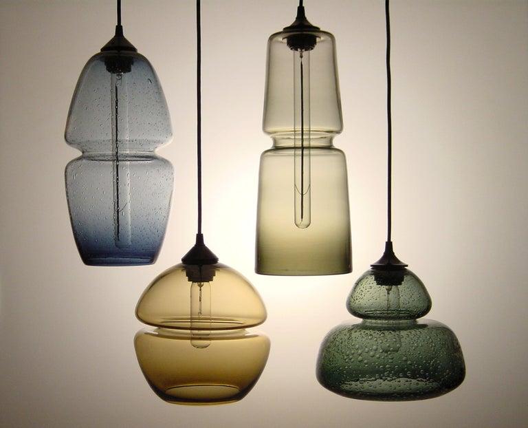 Modern Groove Series Orb Tilt Pendant in Amber, Contemporary Handmade Glass Lighting For Sale