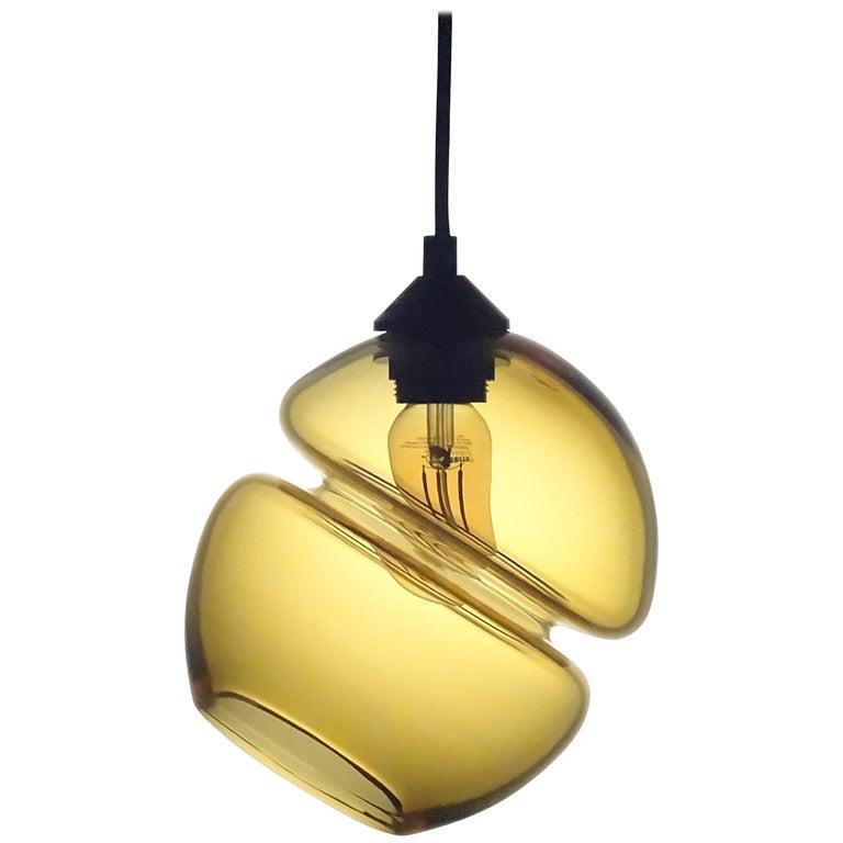 Groove Series Orb Tilt Pendant in Amber, Contemporary Handmade Glass Lighting For Sale