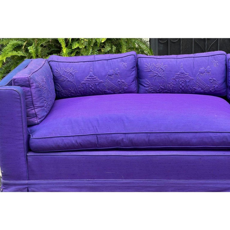 Grosfeld House Hollywood Regency Mid-Century Modern 9' long low sofa. The color is an alexandrite purple with hues of blue in certain light. Features Chinese embroidered cushion with luxurious down fill. No holes or stains. Light fading.