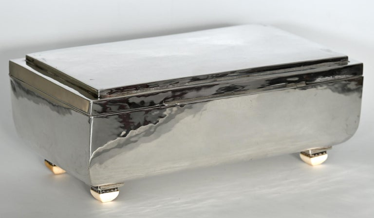 Particularly large and beautiful silver box Art Deco out of sterling silver. Handcrafted, with a light hammer blow, wonderful example of German Art Deco silversmithing  The feet are provided with beautiful details Nice heavy silver quality of 1.2 kg.
