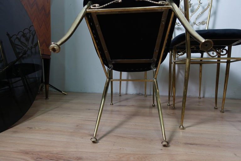 Group 4 chiavarina brass chairs, produced in Italy in 1952, have been polished covered in black fabric.