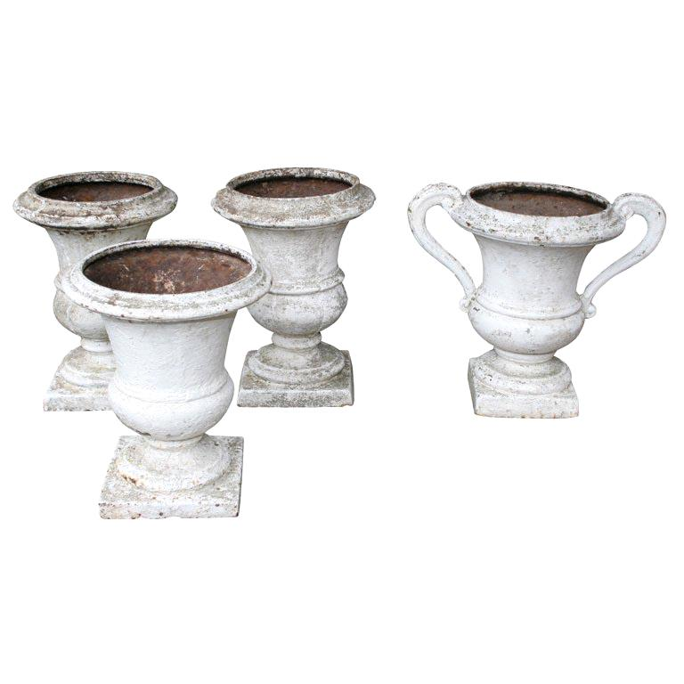 Group of 4 Cast Iron Regence Style Urns For Sale