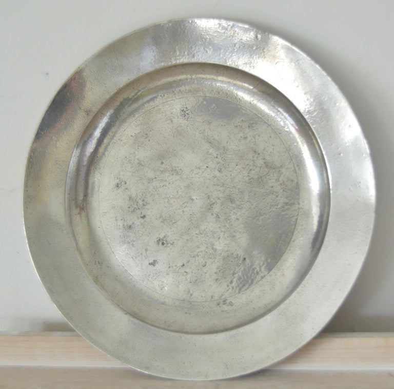 Wonderful group of 18th century polished English pewter chargers. Measures: 16.5 inches.  Great distressed Industrial look.  Some have traces of the old touchmarks and or ownership inscriptions. A lot of these are made in London.  Useful as