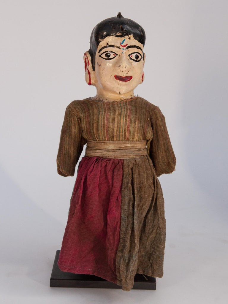 Group of Five Vintage Puppets. Newar People of the Kathmandu Valley, Nepal. Early 20th Century. Mounted. Paper-mâché on a wooden base. Original clothing. All are mounted on metal stands. Condition: The condition of the faces is good but many of the