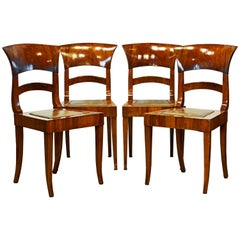 Group of Four Austrian Neoclassical Figured Walnut Side or Dining Chairs