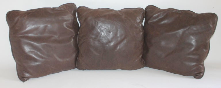These fine distressed Italian kid glove leather pillows are in fine condition with zippers for removing or cleaning. Sold as a group of three.