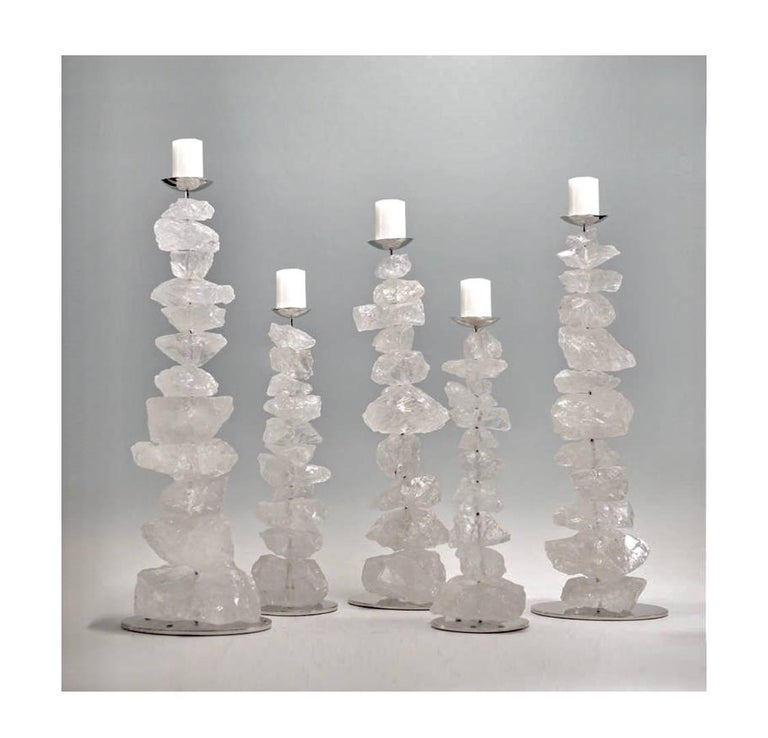 The natural stack of rock crystals mounted as candleholders with nickel-plated stands; Size available in 17