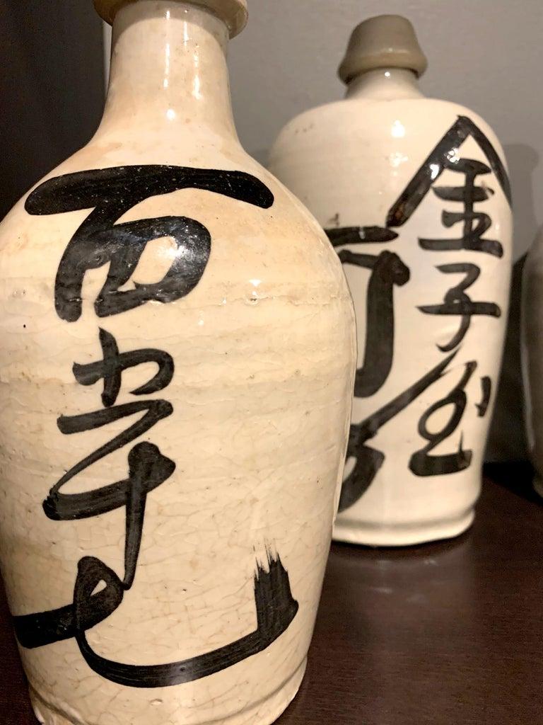 Group of Nine Vintage Japanese Saki Bottle For Sale 7