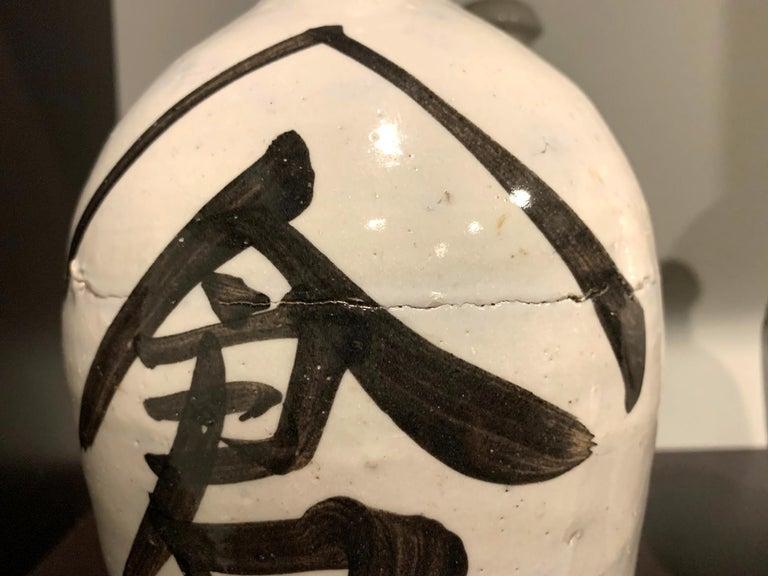 Group of Nine Vintage Japanese Saki Bottle For Sale 8