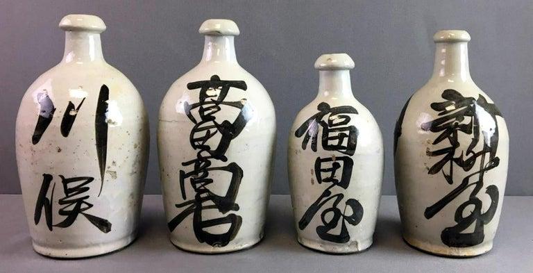 Group of Nine Vintage Japanese Saki Bottle For Sale 1
