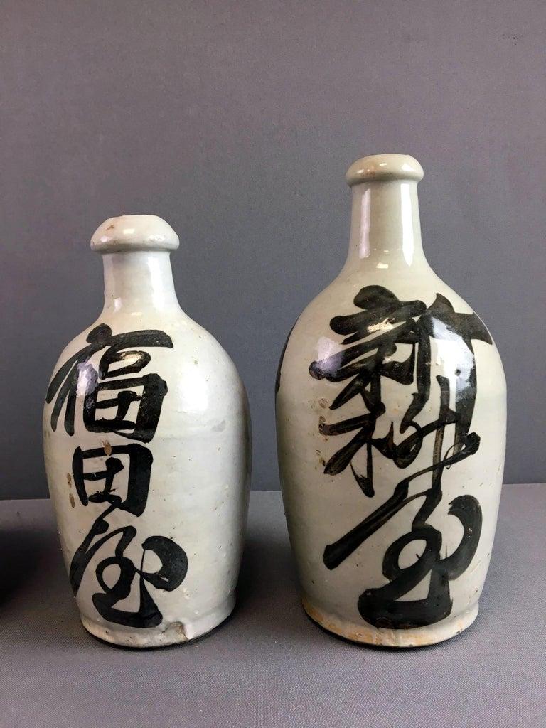 Group of Nine Vintage Japanese Saki Bottle For Sale 2