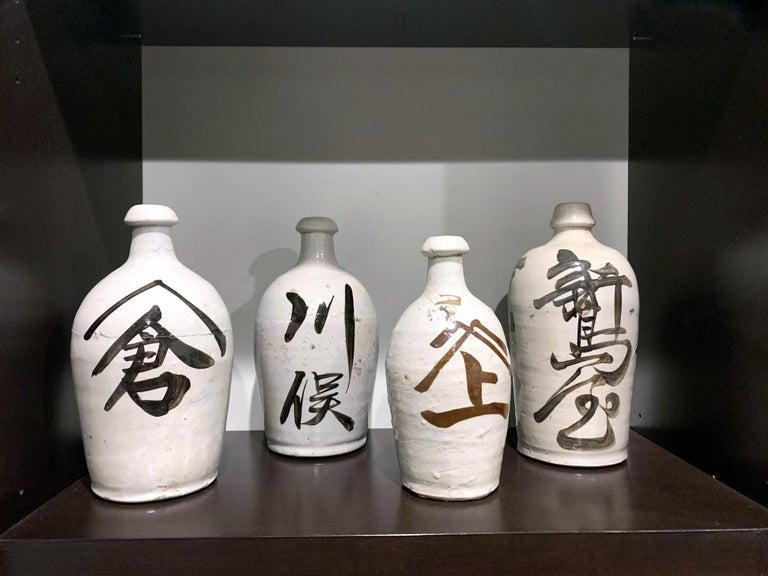 Group of Nine Vintage Japanese Saki Bottle In Good Condition For Sale In Atlanta, GA