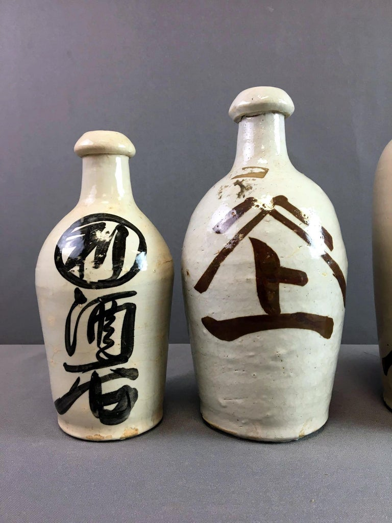 Group of Nine Vintage Japanese Saki Bottle For Sale 3
