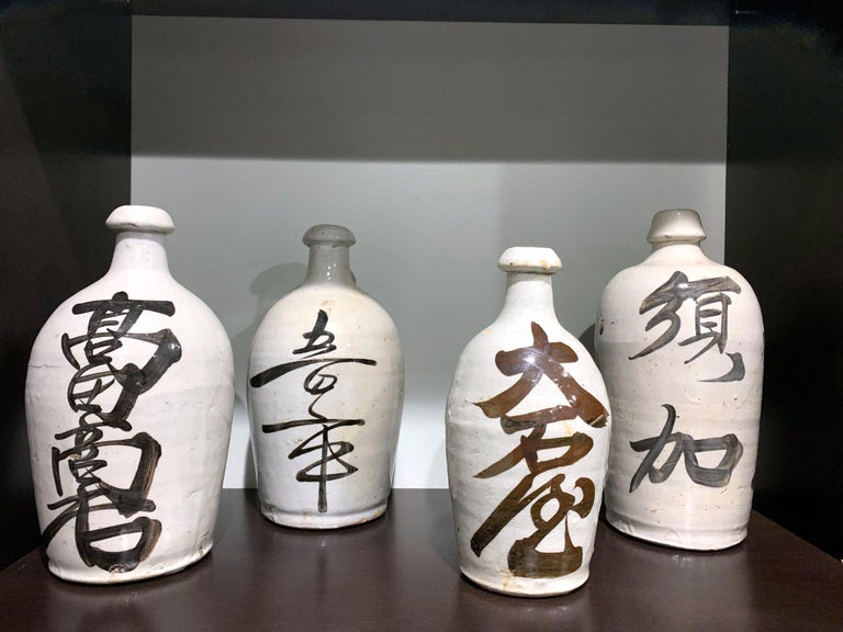 20th Century Group of Nine Vintage Japanese Saki Bottle For Sale