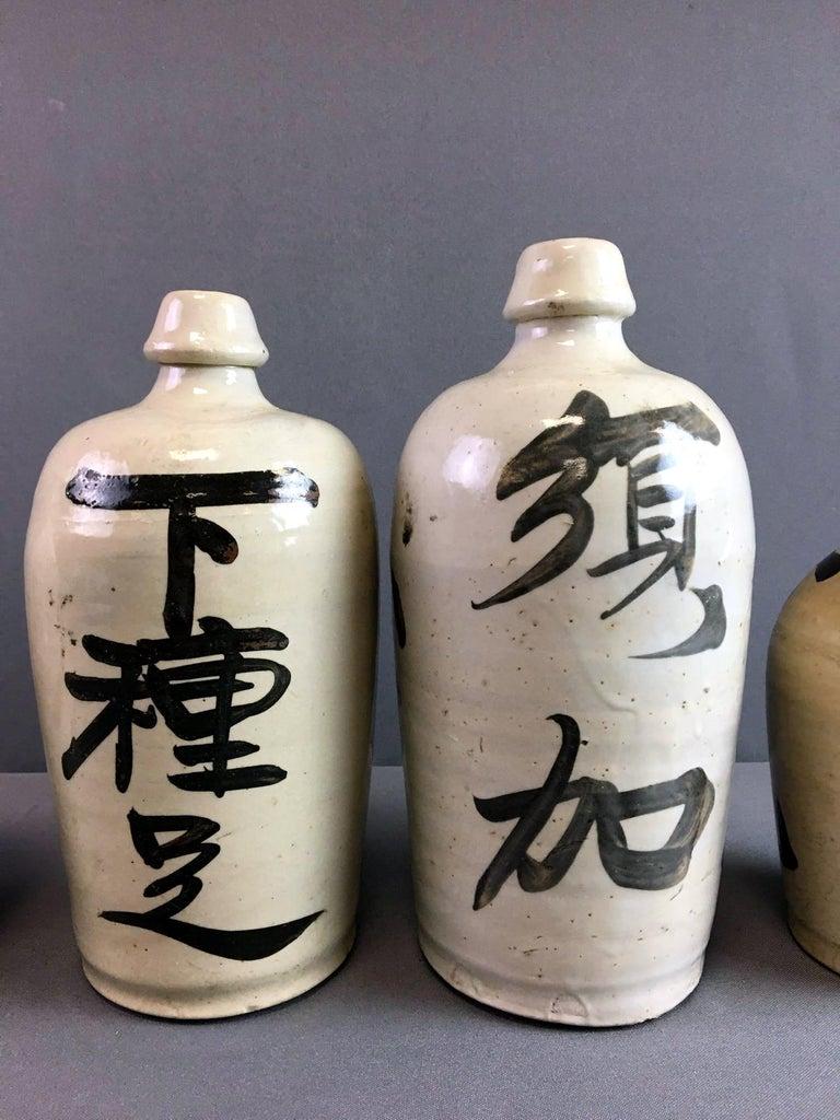 Group of Nine Vintage Japanese Saki Bottle For Sale 4
