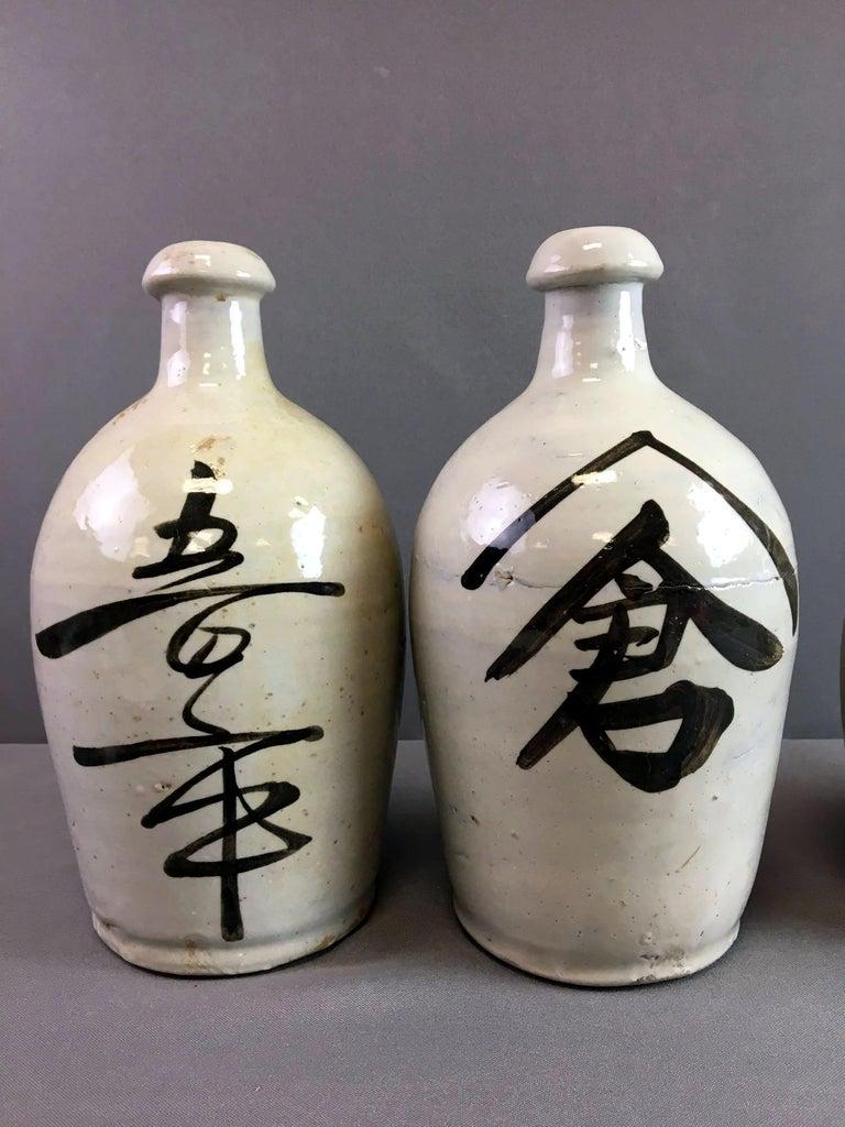Group of Nine Vintage Japanese Saki Bottle For Sale 5