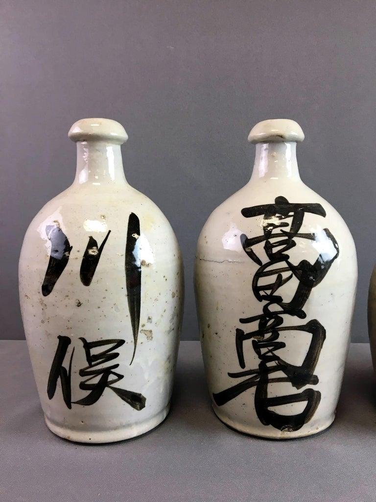 Group of Nine Vintage Japanese Saki Bottle For Sale 6