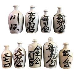 Group of Nine Vintage Japanese Saki Bottle