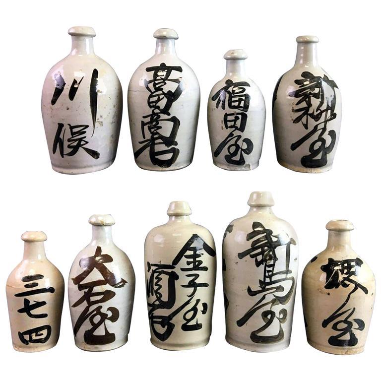 Group of Nine Vintage Japanese Saki Bottle For Sale