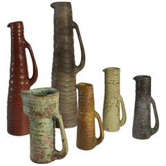 Group of Six Whimsical Midcentury Ceramic Studio Vases in Muted Colors
